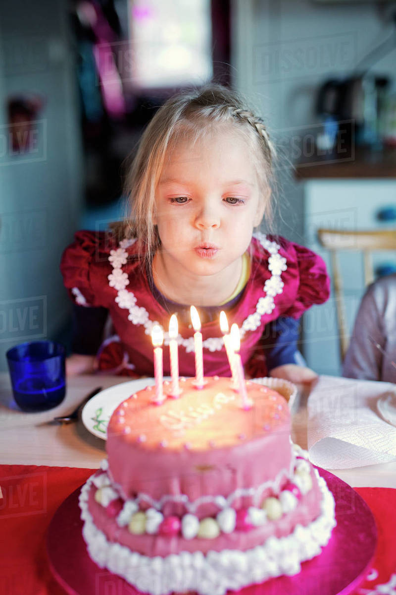 Finland Girl 4 5 Blowing Out Candles On Birthday Cake Stock