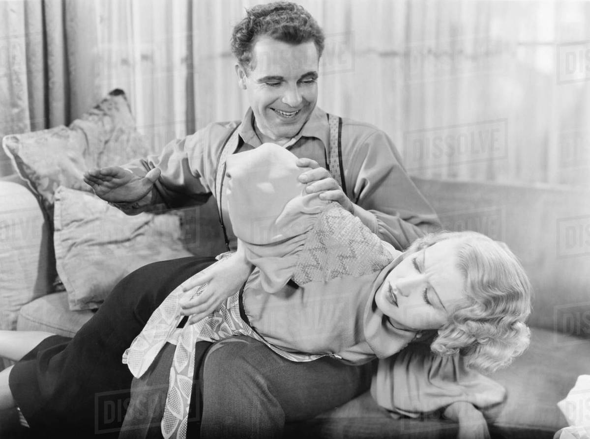 Man spanking a woman