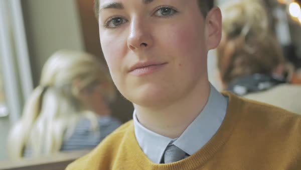 Hand-held shot of a genderqueer person looking at camera Royalty-free stock video