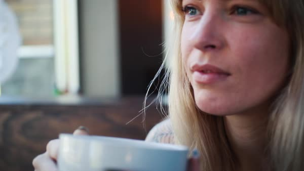 Hand-held shot of a woman holding a cup Royalty-free stock video