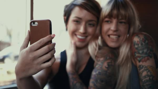 Hand-held shot of two women taking a selfie Royalty-free stock video