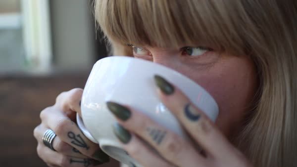 Hand-held shot of a woman drinking tea Royalty-free stock video