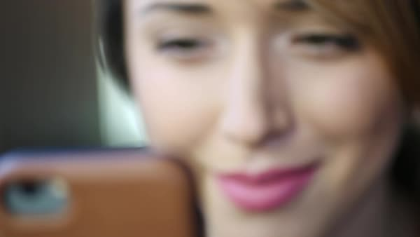 Hand-held shot of a woman looking at a cell phone Royalty-free stock video