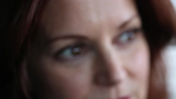 Hand-held shot of a woman looking at camera Royalty-free stock video