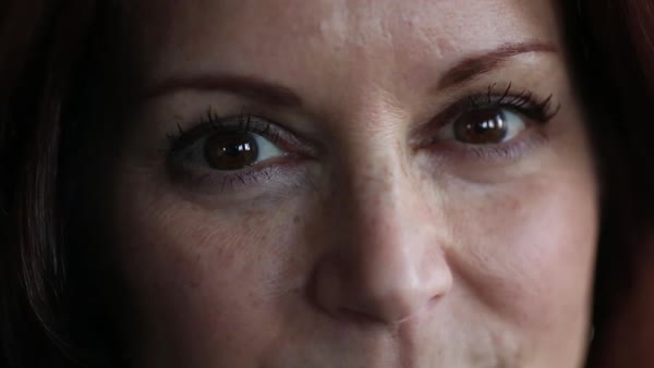 Hand-held shot view of a woman looking at camera Royalty-free stock video