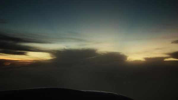 Hand-held shot of an airplane flying through clouds at sunset Royalty-free stock video
