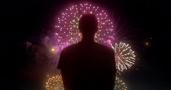 Hand-held shot of a man watching fireworks Royalty-free stock video