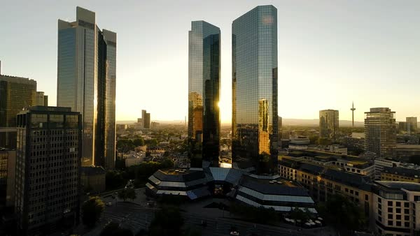 Establishing shot of city scape with skyscrapers and business towers at dusk in Frankfurt Royalty-free stock video