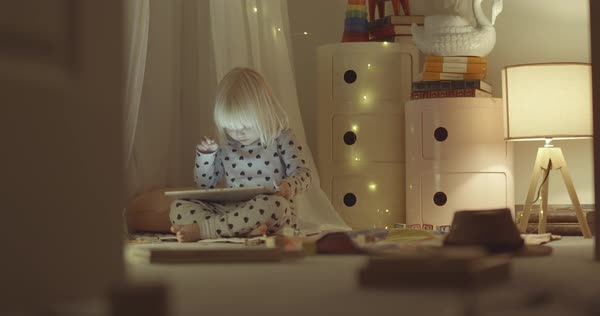 Static shot of a little girl using a tablet Royalty-free stock video