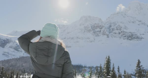 Slow motion shot of a woman looking at the snowy mountains Royalty-free stock video