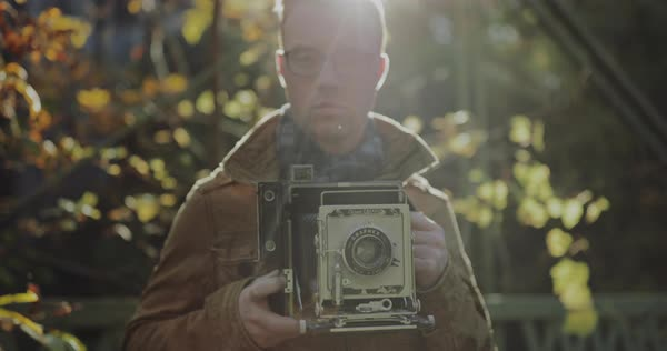 Gimbal shot of a photographer holding a vintage camera Royalty-free stock video