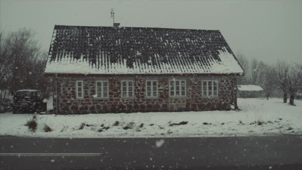 Falling snow over house by road Royalty-free stock video
