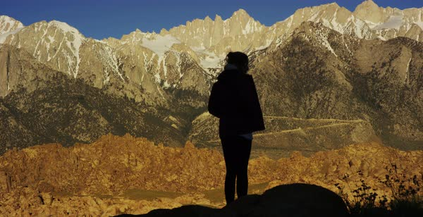 Static shot of a woman enjoying view of Sierra Nevada mountains Royalty-free stock video