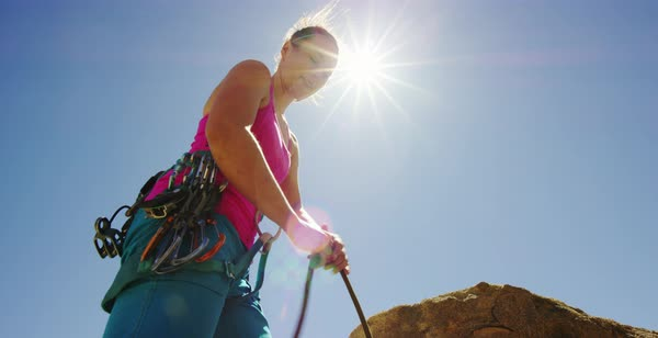 Hand-held shot of a woman getting ready to climb a rock Royalty-free stock video