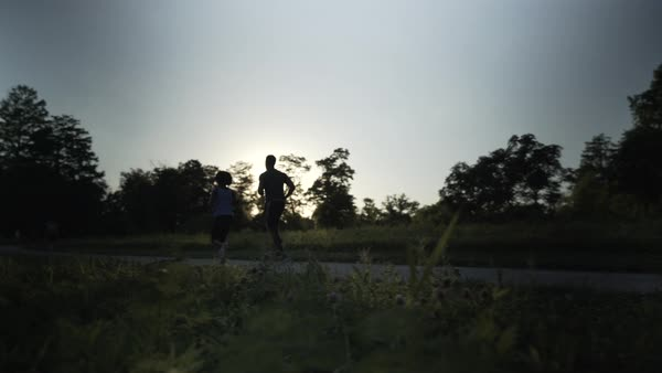 Gimbal shot of a couple running together Royalty-free stock video
