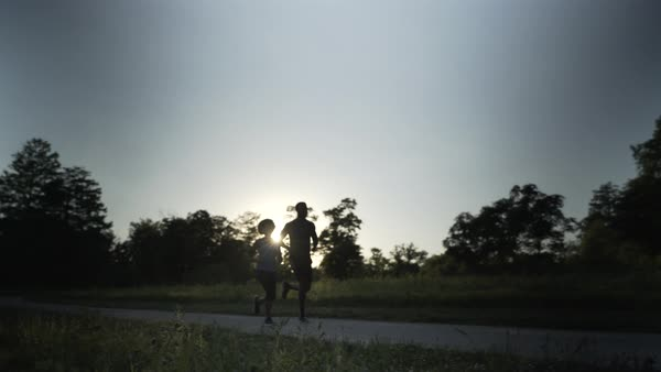 Gimbal shot of a man and a woman running together Royalty-free stock video