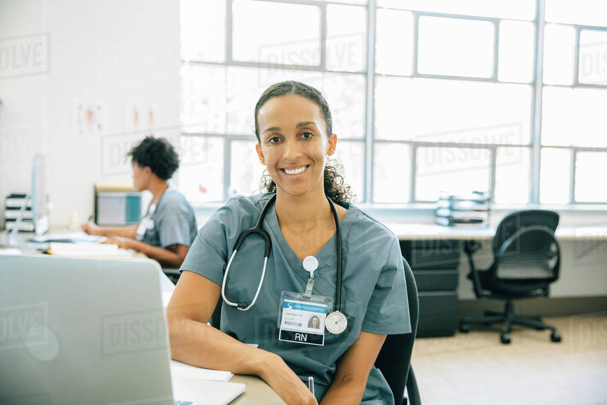 Portrait of smiling nurse with laptop Royalty-free stock photo