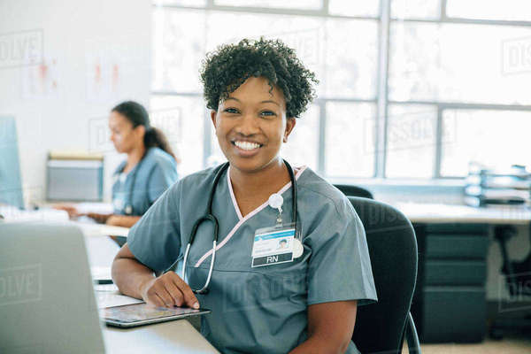 Portrait of smiling nurse with digital tablet Royalty-free stock photo