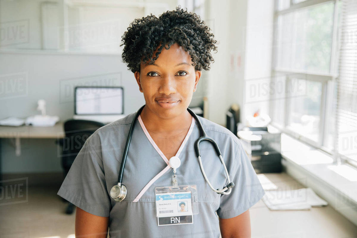 Portrait of nurse near window Royalty-free stock photo