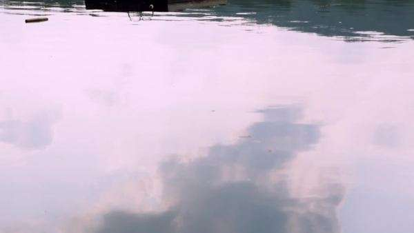 Reflection of sky and wooden dock on lake Royalty-free stock video