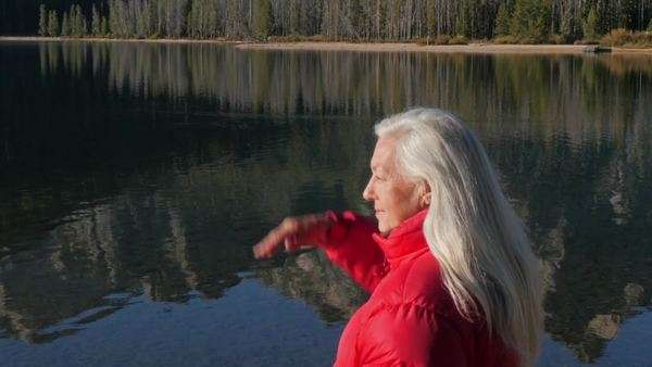 Woman standing at lake Royalty-free stock video