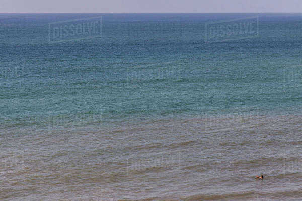 Aerial view of surfer floating on ocean waves Royalty-free stock photo