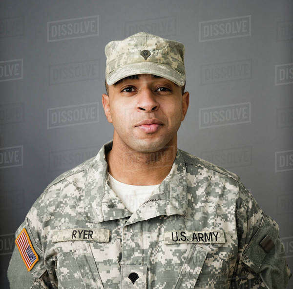 Close up of mixed race soldier smiling Royalty-free stock photo