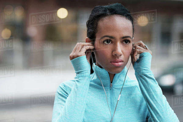 Mixed race runner listening to earbuds Royalty-free stock photo