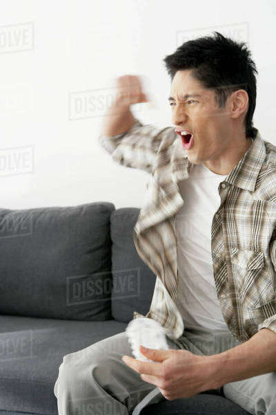 Asian man playing video games Royalty-free stock photo