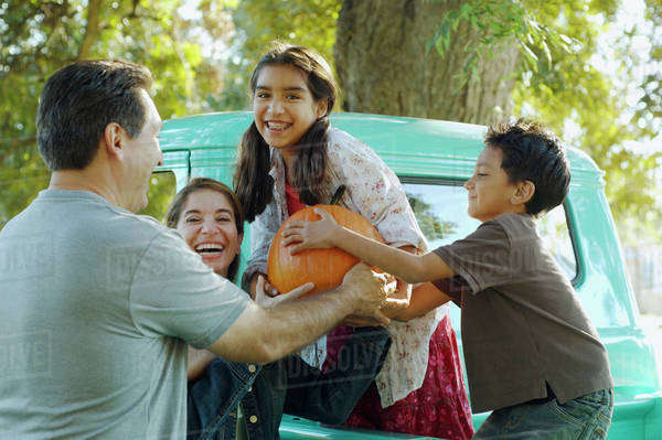 Multi-ethnic family holding pumpkin Royalty-free stock photo