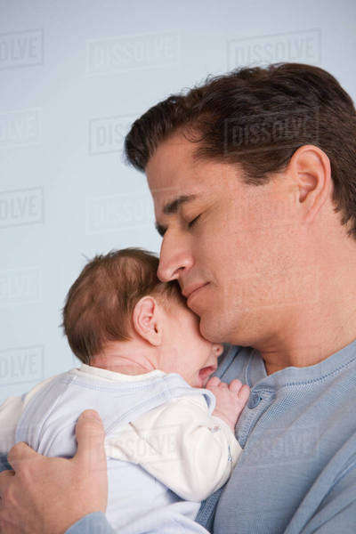 Hispanic father hugging baby Royalty-free stock photo