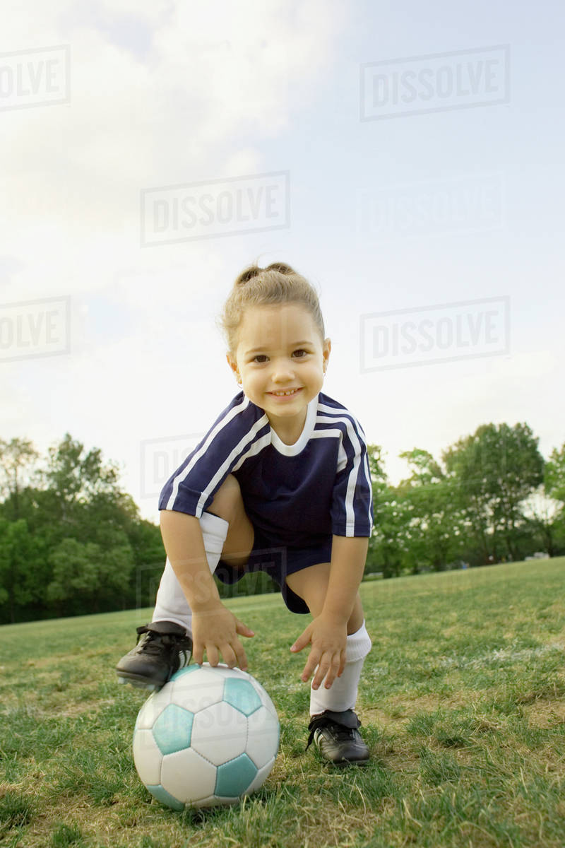 2b76306ce Young girl in athletic gear with soccer ball - Stock Photo - Dissolve