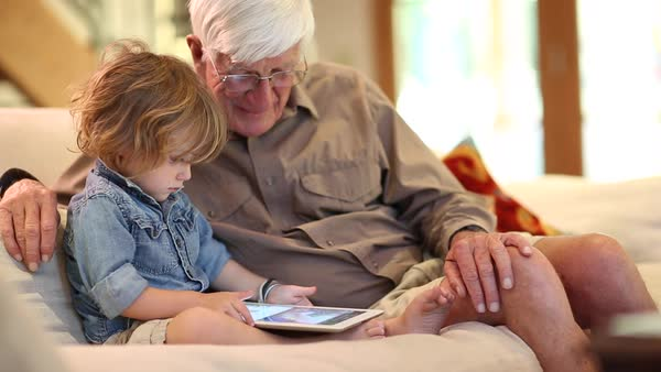 Grandfather and grandson using digital tablet Royalty-free stock video