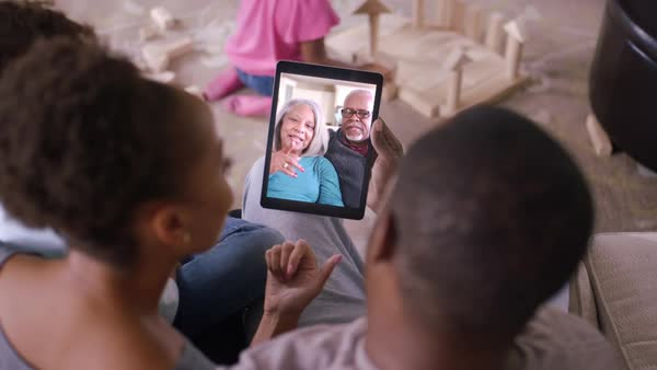 Family video chatting with grandparents Royalty-free stock video