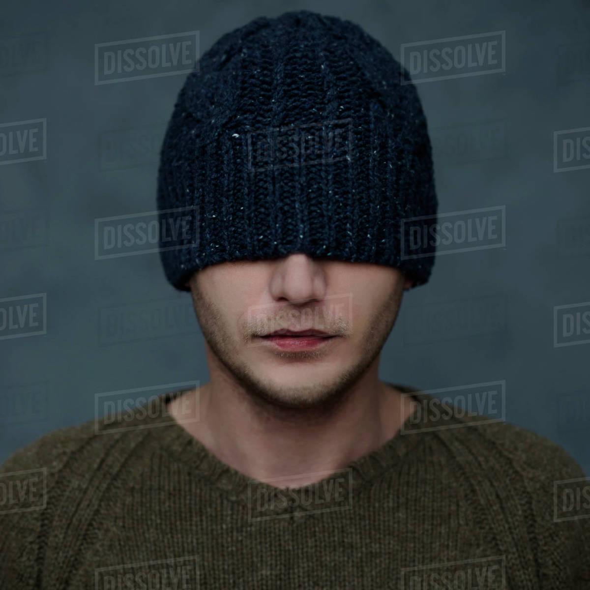 Caucasian man wearing beanie hat over eyes - Stock Photo - Dissolve d2e1126c345