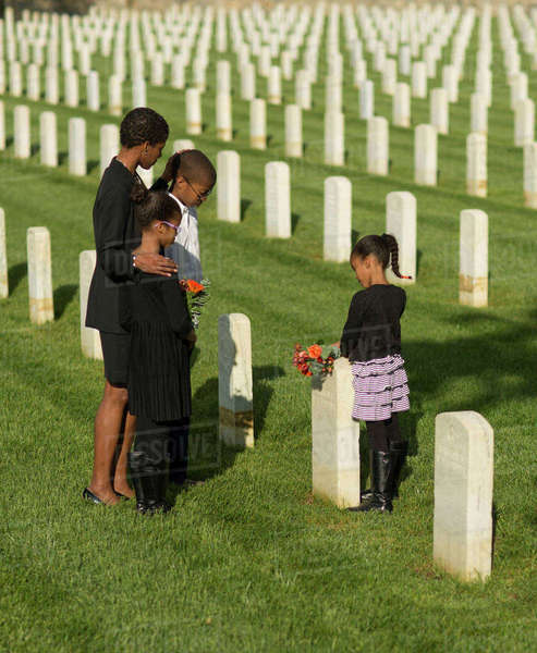 Black family at military cemetery Royalty-free stock photo
