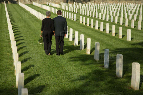 Black couple walking in military cemetery Royalty-free stock photo
