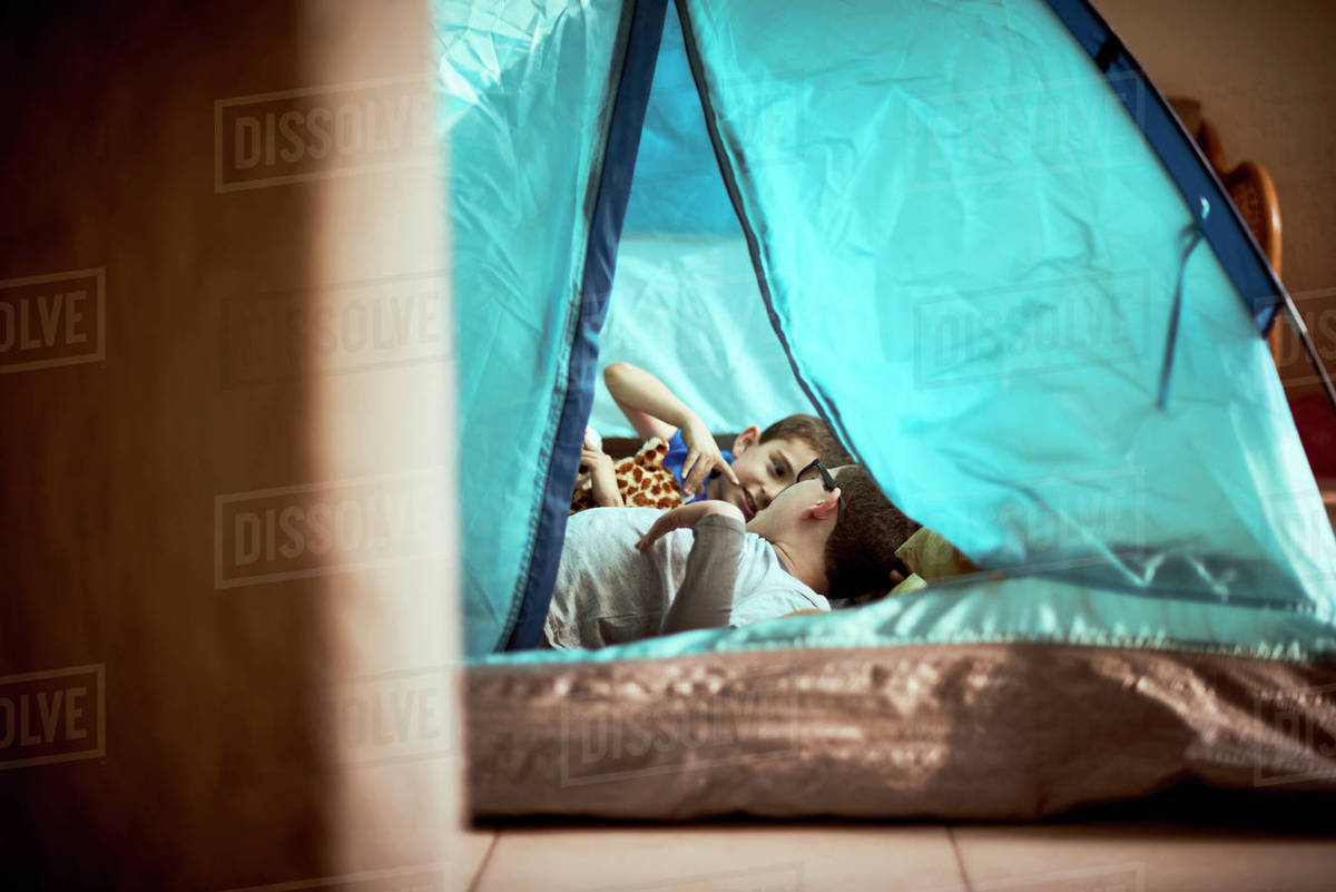 Hispanic boys camping in tent indoors stock photo