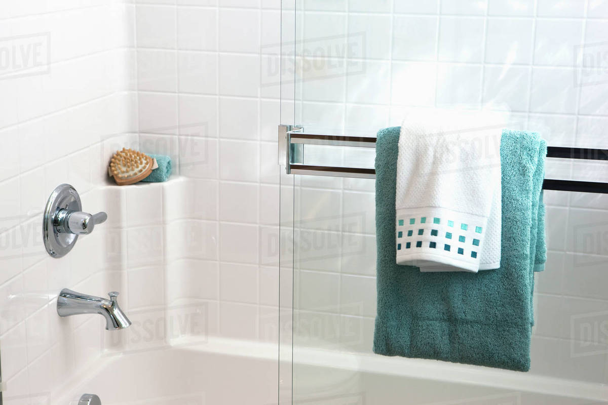 Towels on sliding glass shower door in bathroom, Tustin, California ...