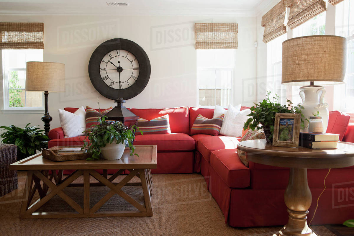 Contemporary living room with red sectional sofa and large wall D145_200_884