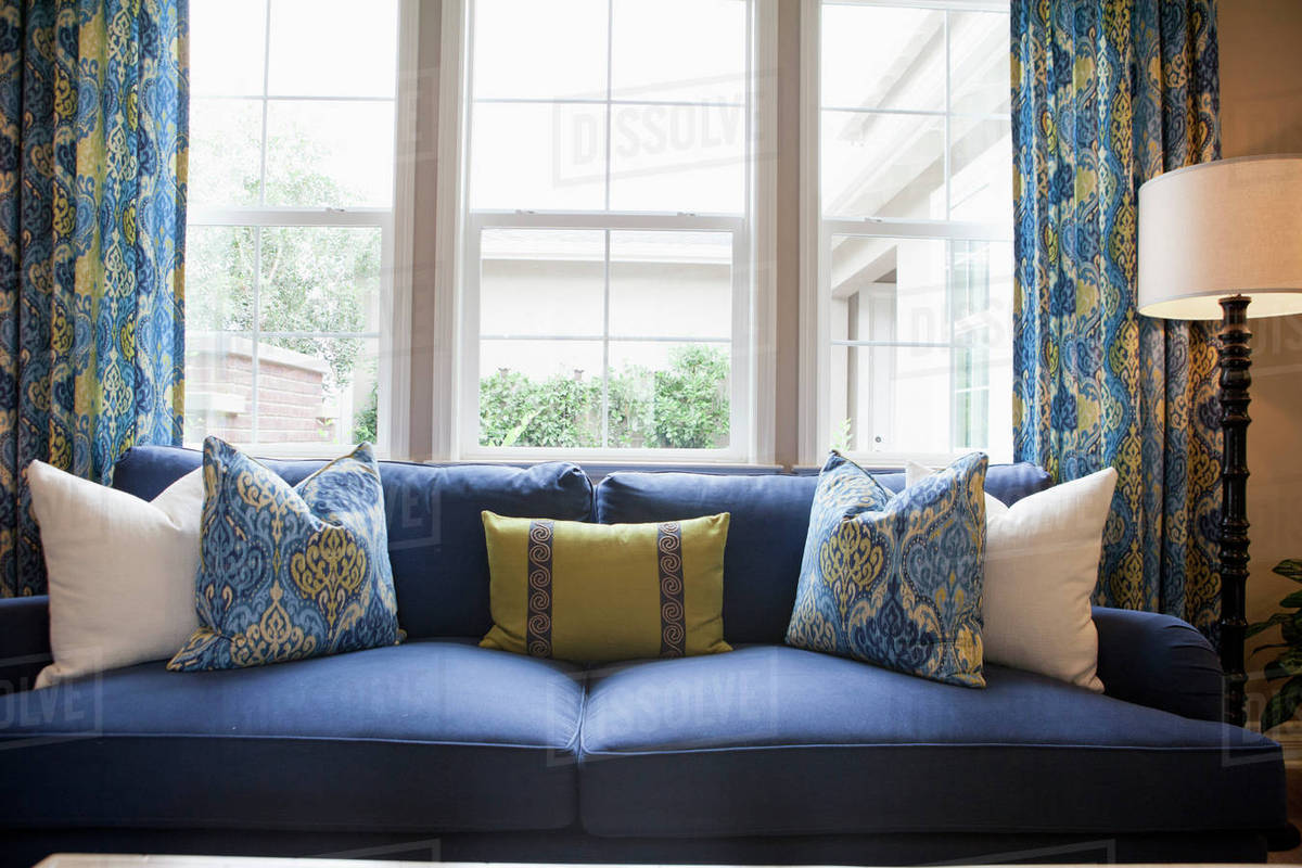 Attirant Close Up Of Cushions On Blue Couch Against Window In The Living Room At Home