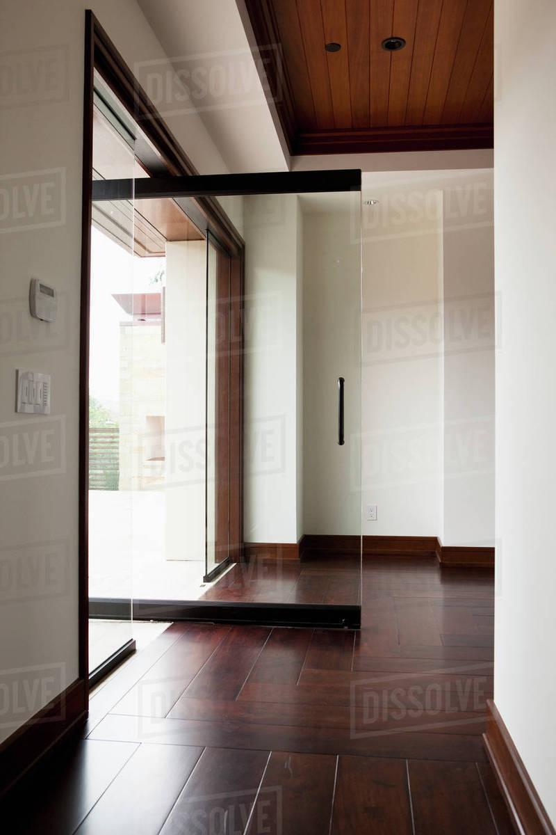 Hallway With Wooden Floor And Open Glass Door Stock Photo Dissolve