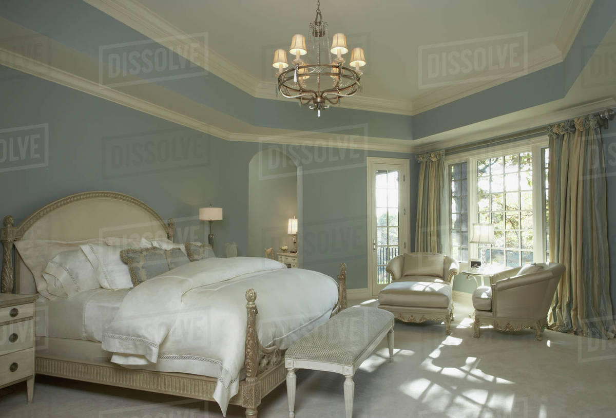 Soft blue walls white woodwork french style white bedding light soft blue walls white woodwork french style white bedding light stained furniture chandelier sitting area in front of window striped curtains aloadofball Images