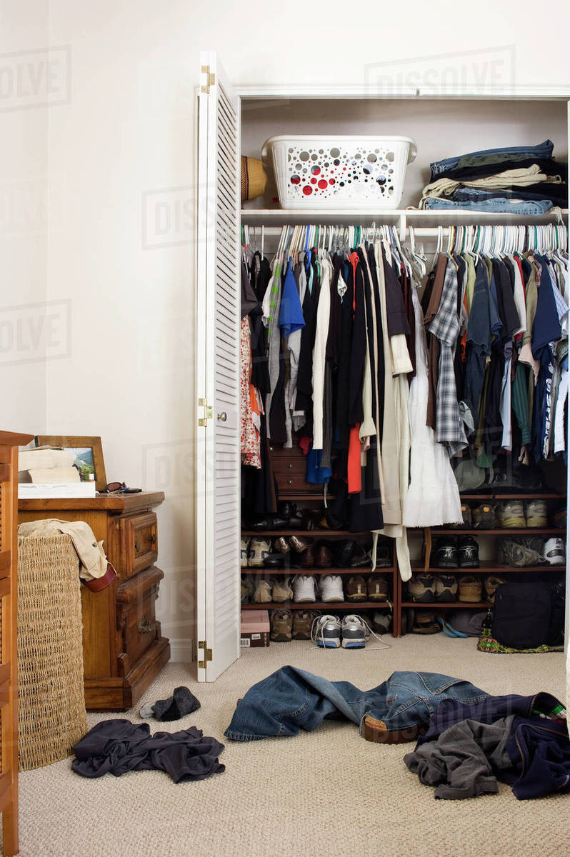Scattered Clothes Outside Cluttered Closet, San Diego, California, United  States Of America