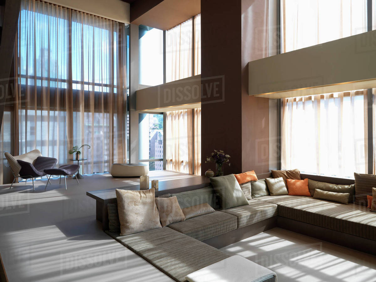 Modern living room with step down to sofa - Stock Photo - Dissolve