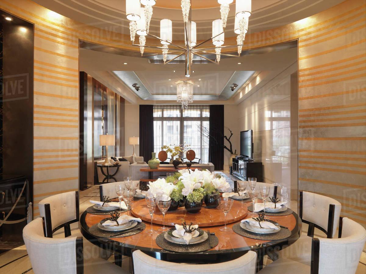 Circular Dining Table In Elegant Modern Home Stock Photo Dissolve