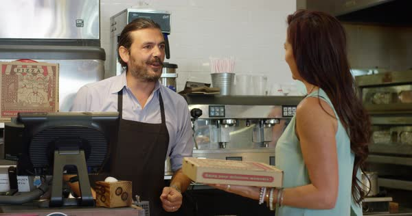Customer paying cashier for pizza Royalty-free stock video