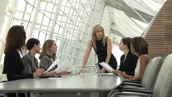 Businesswomen meeting at conference table with paperwork Royalty-free stock video