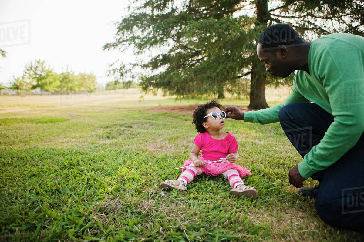 Black father and daughter enjoying the park Royalty-free stock photo