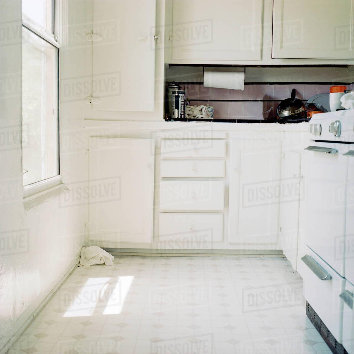 White apartment kitchen cabinets stock photo